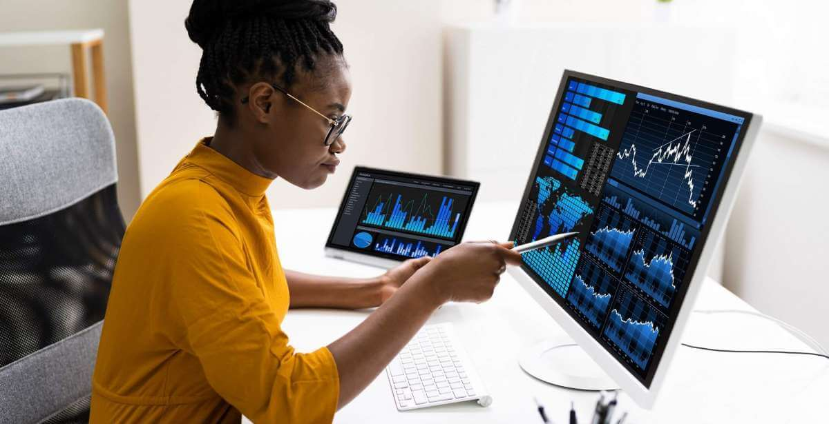 Data Analyst reviewing reports